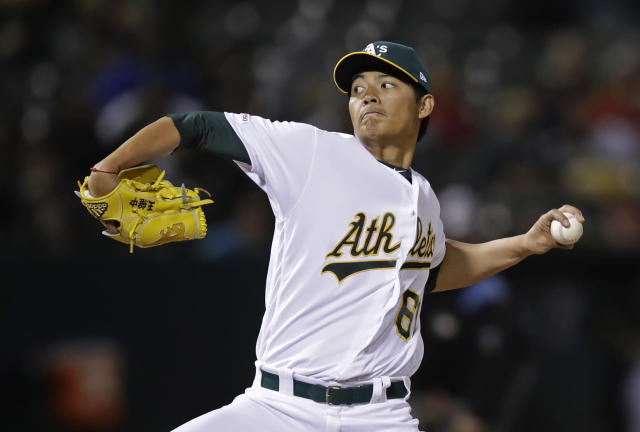 Oakland Athletics pitcher Wei-Chung Wang works against the Los Angeles Angels in the fifth inning of a baseball game, Tuesday, May 28, 2019, in Oakland, Calif. (AP Photo/Ben Margot)