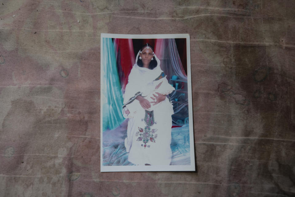 A photograph of Letay, the deceased wife of 40-year-old Tigrayan Abraha Kinfe Gebremariam, is seen inside her family's shelter in Hamdayet, eastern Sudan, near the border with Ethiopia, on March 14, 2021. Letay experienced a seemingly normal pregnancy in the Tigrayan region of Ethiopia. But ten days after giving birth to twin daughters, she passed away. (AP Photo/Nariman El-Mofty)
