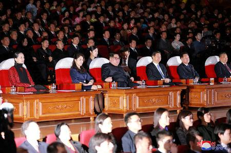 North Korean leader Kim Jong Un, his wife Ri Sol Ju and Song Tao, head of the International Department of Communist Party of China (CPC) Central Committee, watch a ballet performance in this undated photo released by North Korea's Korean Central News Agency (KCNA) in Pyongyang April 17, 2018. KCNA/via Reuters