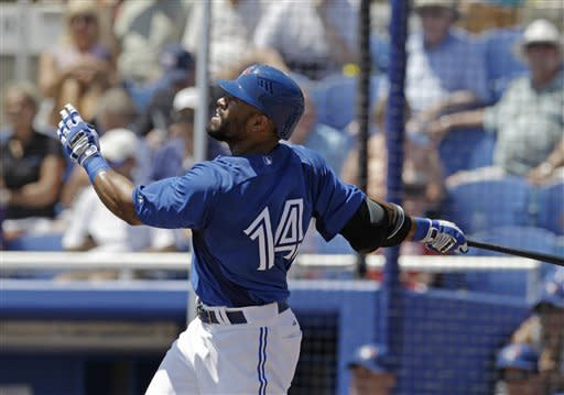Toronto Blue Jays left fielder Eric Thames watches his third-inning solo home run off Detroit Tigers starting pitcher Max Scherzer in their spring training baseball game in Dunedin, Fla., Tuesday, April 3, 2012. (AP Photo/Kathy Willens)