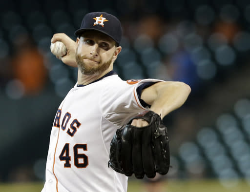 Houston Astros' Scott Feldman delivers a pitch against the Oakland Athletics in the first inning of a baseball game Monday, Aug. 25, 2014, in Houston. (AP Photo/Pat Sullivan)