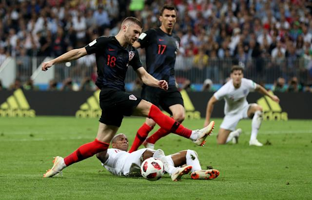 <p>Ashley Young of England tackles Ante Rebic of Croatia during the 2018 FIFA World Cup Russia Semi Final match between England and Croatia at Luzhniki Stadium on July 11, 2018 in Moscow, Russia. (Photo by Clive Rose/Getty Images) </p>