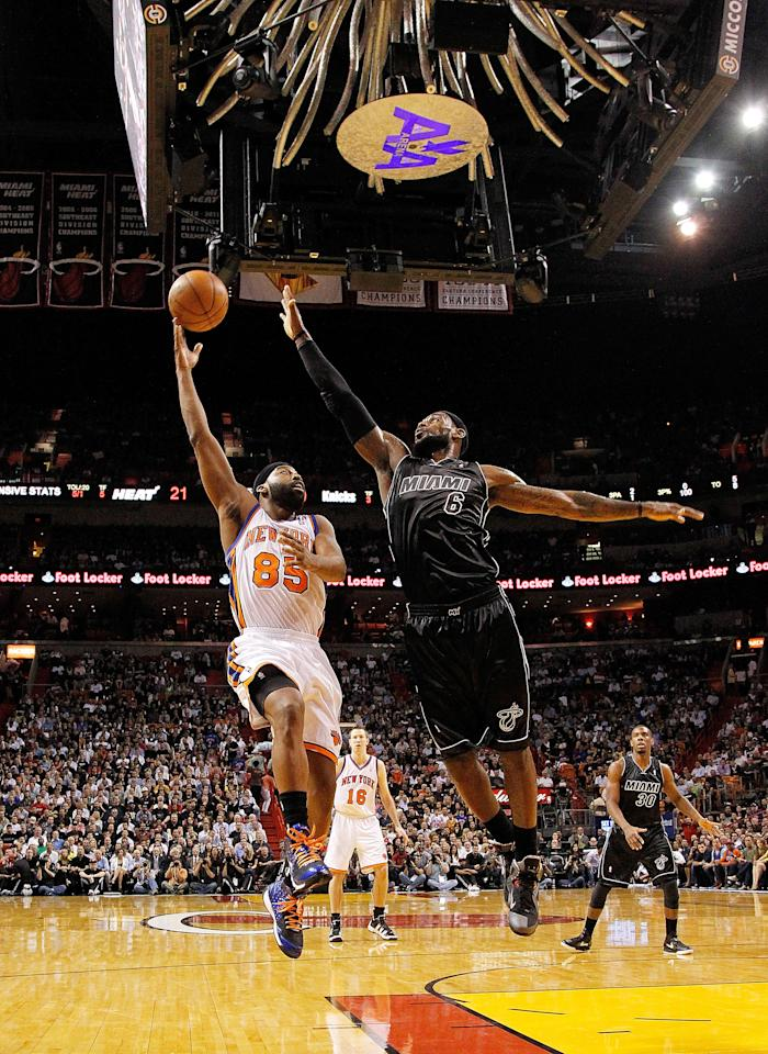 MIAMI, FL - FEBRUARY 23: Baron Davis #85 of the New York Knicks shoots over LeBron James #6 of the Miami Heat during a game  at American Airlines Arena on February 23, 2012 in Miami, Florida. NOTE TO USER: User expressly acknowledges and agrees that, by downloading and/or using this Photograph, User is consenting to the terms and conditions of the Getty Images License Agreement.  (Photo by Mike Ehrmann/Getty Images)