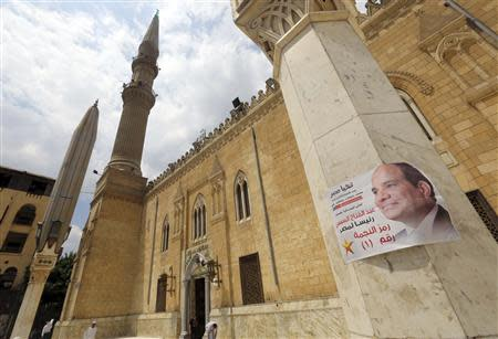 Election poster of Egypt's former army chief Abdel Fattah al-Sisi is seen on a column at Al-Hussein mosque in the old Islamic area of Cairo