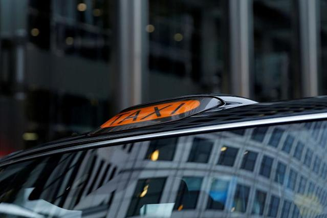 FILE PHOTO: A taxi sign on top of an electric cab belonging to the London Electric Vehicle Company (LEVC) is seen in London, Britain, November 29, 2017. REUTERS/Darrin Zammit Lupi/File Photo