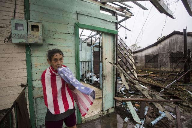<p>A woman covers herself with a towel in front of damaged buildings in Punta Alegre, northern coast of Ciego de Avila province of Cuba after Hurricane Irma passed through the area on Sept. 11, 2017. (Photo: Yander Zamora/Anadolu Agency/Getty Images) </p>