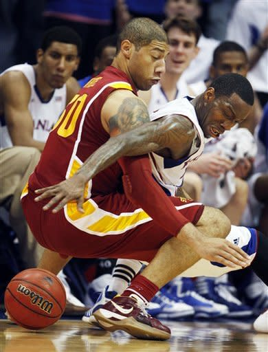 Iowa State forward Royce White (30) battles Kansas guard Tyshawn Taylor (10) for the ball during the second half of an NCAA college basketball game in Lawrence, Kan., Saturday, Jan. 14, 2012. Kansas won 82-73. (AP Photo/Orlin Wagner)