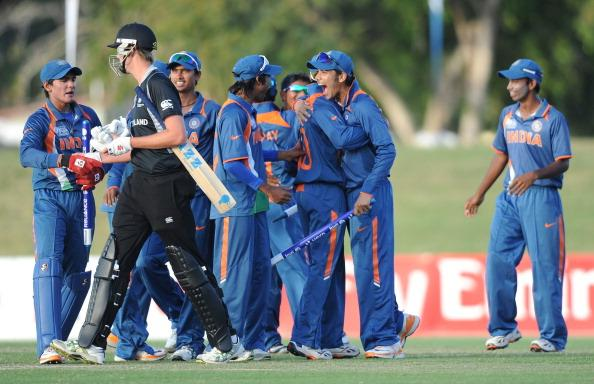 TOWNSVILLE, AUSTRALIA - AUGUST 23:  The Indian team celebrates victory during the ICC U19 Cricket World Cup 2012 Semi Final match between India and New Zealand at Tony Ireland Stadium on August 23, 2012 in Townsville, Australia.  (Photo by Malcolm Fairclough-ICC/Getty Images)