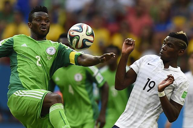 Nigeria's defender Joseph Yobo (L) and France's midfielder Paul Pogba vie for the ball during a Round of 16 football match between France and Nigeria at Mane Garrincha National Stadium in Brasilia during the 2014 FIFA World Cup on June 30, 2014 (AFP Photo/Odd Andersen)