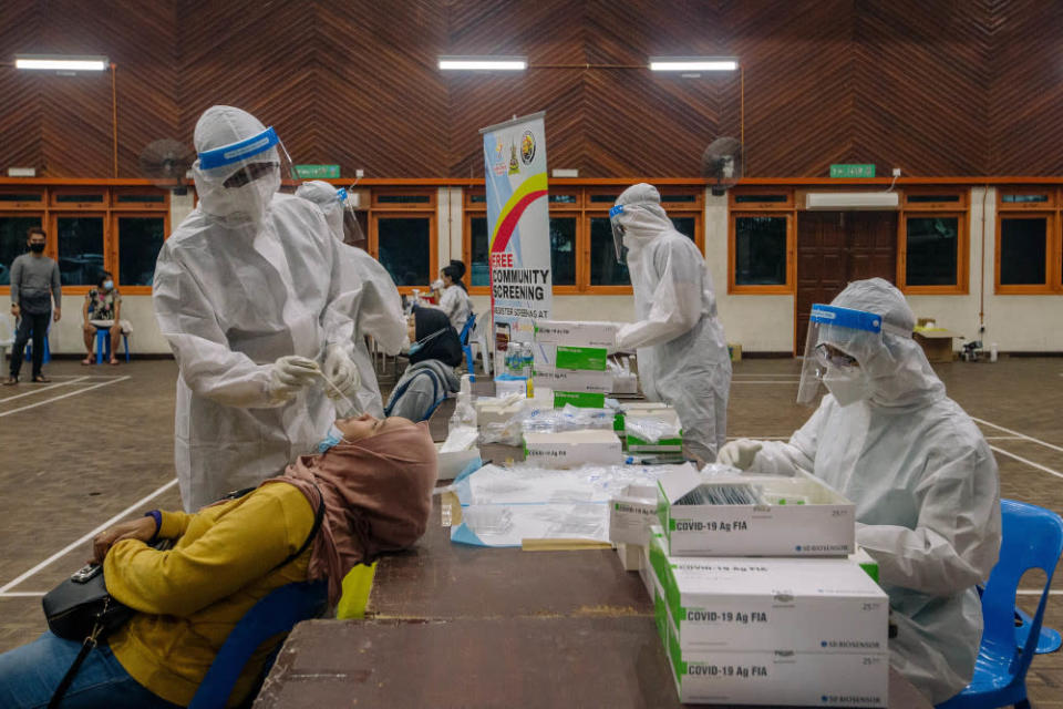Healthcare workers in protective suits are seen conducting Covid-19 testing in Ampang May 18, 2021. — Picture by Firdaus Latif