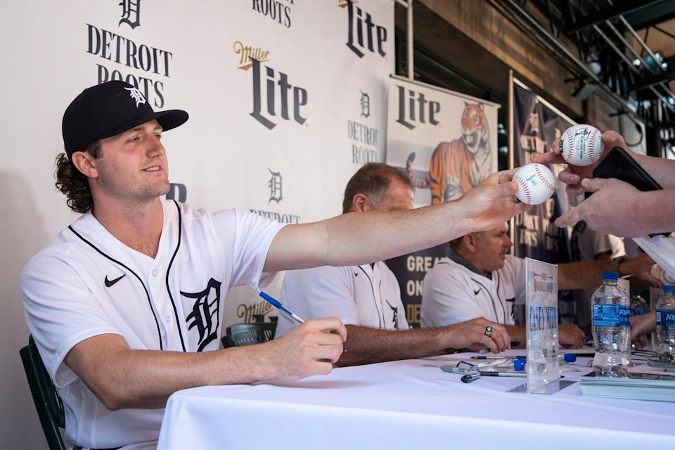 Tigers pitcher Casey Mize signs autographs for fans during the Summer Baseball Bash at Comerica Park in Detroit, Saturday, July 17, 2021.