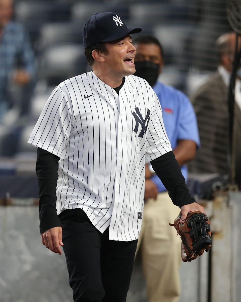 Jimmy Fallon takes the field at Tuesday's game between the New York Yankees and Texas Rangers at Yankee Stadium.