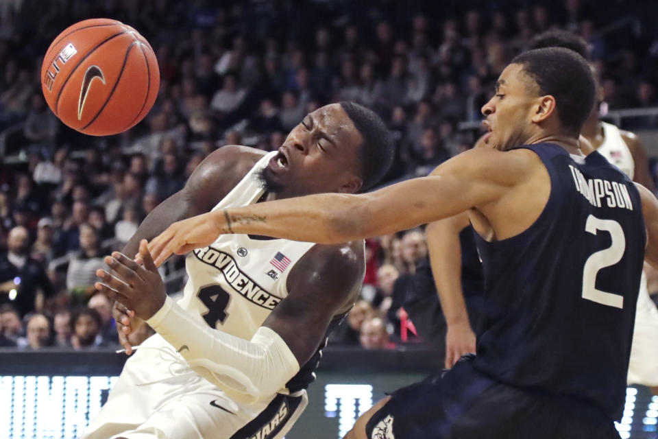 Butler guard Aaron Thompson (2) knocks the ball loose as Providence guard Maliek White (4) drives during the second half of an NCAA college basketball game Friday, Jan. 10, 2020, in Providence, R.I. Butler won 70-58. (AP Photo/Elise Amendola)