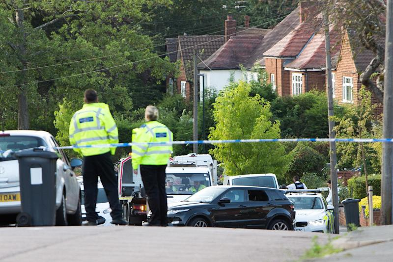 Police examine the Range Rover in Moorcroft Road, Moseley, Birmingham (Picture: SWNS)