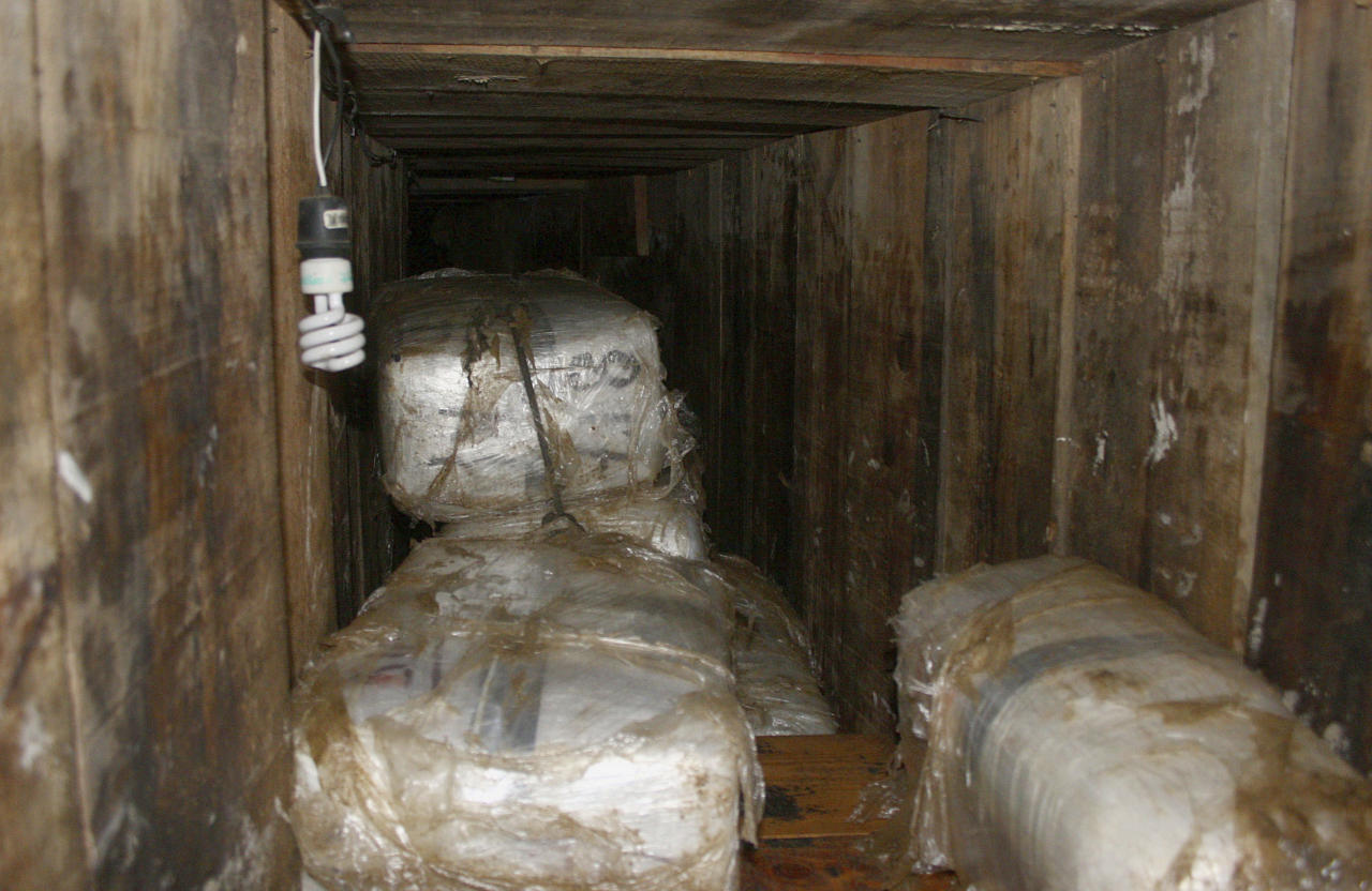 Packs of marijuana are stored in a tunnel in Tijuana November 3, 2010. U.S. border police have found a sophisticated drug smugglers' tunnel the length of six football fields linking Southern California with Mexico and arrested two people, authorities said on Wednesday. Agents recovered more than 25 tonnes of marijuana in seizures related to the investigation in both California and Mexico and arrested a U.S. citizen and his Mexican wife. Picture taken November 3, 2010. REUTERS/Jorge Duenes (MEXICO - Tags: POLITICS CRIME LAW SOCIETY)