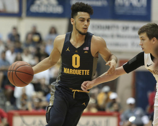 "Marquette guard <a class=""link rapid-noclick-resp"" href=""/ncaab/players/135987/"" data-ylk=""slk:Markus Howard"">Markus Howard</a> tied a Big East record with 52 points on Wednesday night. (AP Photo/Marco Garcia)"