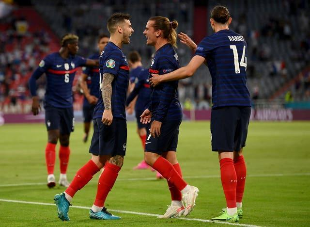 Griezmann, second right, celebrates France's goal against Germany with his team-mates