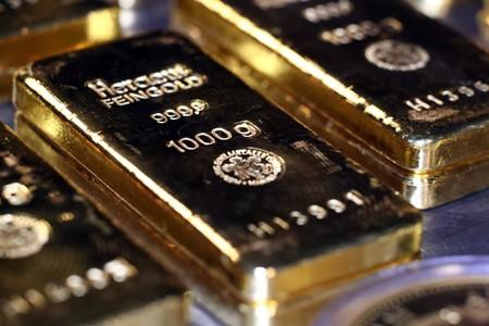 Gold drops as equities surge, but eyes third weekly gain