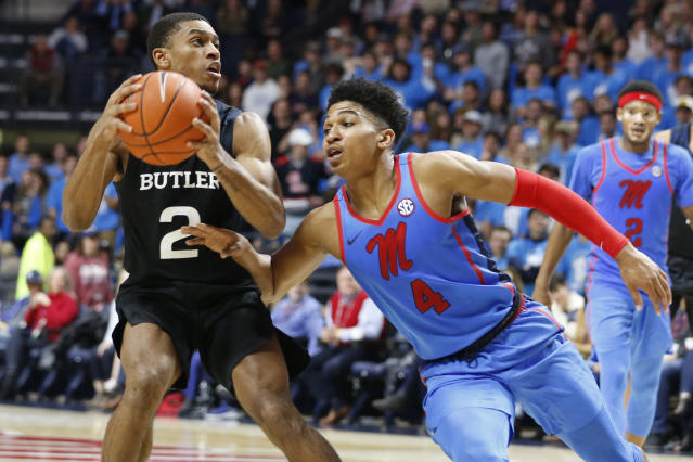 Butler guard Aaron Thompson (2) looks for a shot while Mississippi guard Breein Tyree (4) attempts to steal the ball during the second half of an NCAA college basketball game in Oxford, Miss., Tuesday, Dec. 3, 2019. Butler won 67-58. (AP Photo/Rogelio V. Solis)