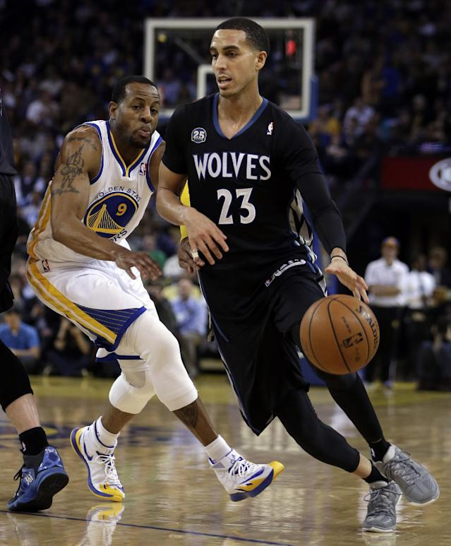 Minnesota Timberwolves' Kevin Martin (23) drives the ball past Golden State Warriors' Andre Iguodala, left, during the second half of an NBA basketball game Friday, Jan. 24, 2014, in Oakland, Calif. (AP Photo/Ben Margot)