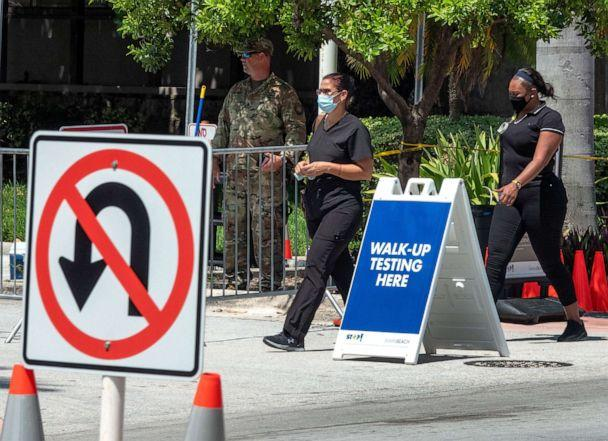 PHOTO: Two women enter the coronavirus walk-up testing service run by the National Guard, partnered with the City of Miami Beach and the Florida Department of Health, at the testing Location at Miami Beach Convention Center in Florida, July 15, 2020. (Cristobal Herrera-Ulashkevich/EPA via Shutterstock)
