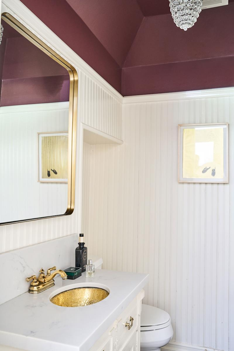 """I said, 'Let's go all out with color,'"" Wark says. And Blair agreed, hence the plum ceiling in the powder room off the entryway."