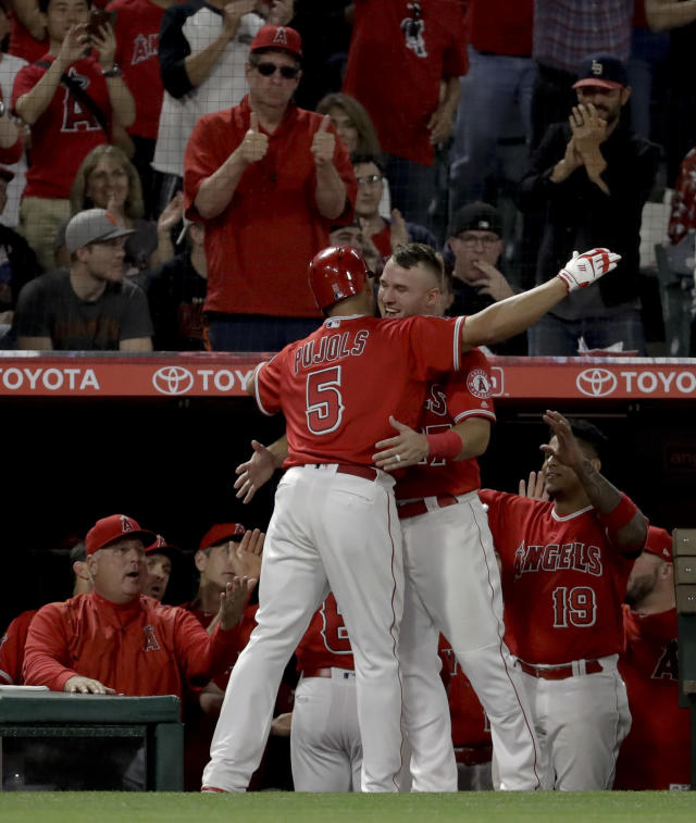 Los Angeles Angels' Albert Pujols (5) celebrates with Mike Trout after his two-run home run against the San Francisco Giants during the sixth inning of a baseball game in Anaheim, Calif., Saturday, April 21, 2018. (AP Photo/Chris Carlson)