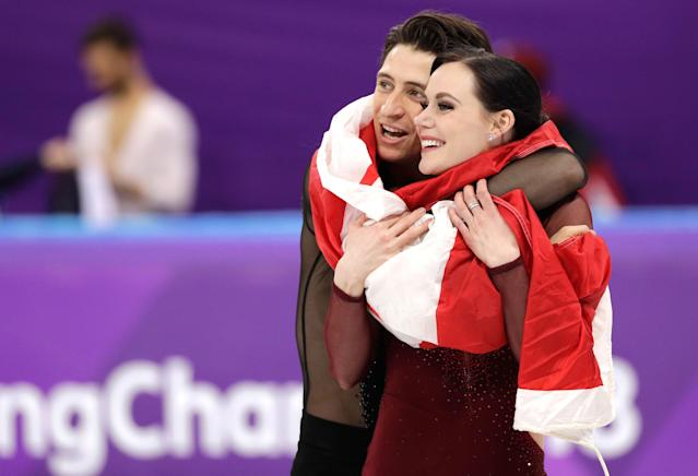 <p>Tessa Virtue and Scott Moir of Canada celebrate during the venue ceremony after winning the gold medal in the ice dance, free dance figure skating final in the Gangneung Ice Arena at the 2018 Winter Olympics in Gangneung, South Korea, Tuesday, Feb. 20, 2018. (AP Photo/David J. Phillip) </p>