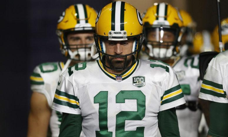 Aaron Rodgers leading his Green Bay Packers team onto the field.