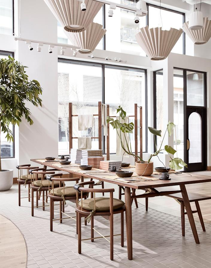 The store's dining area will serve double duty: by day, a retail display, and by night, a space for dinners and events. The arched front doors were inspired by Fritz Hansen.