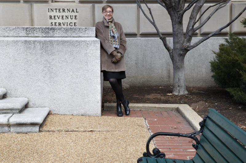 Nina E. Olson, executive director of the Center for Taxpayer Rights, and a former National Taxpayer Advocate for the IRS, poses for portrait by the IRS building, Tuesday, Jan. 28, 2020, in Washington. While her role was within the IRS, it was independent of the agency and she was often considered one of its most vocal critics. She retired in July and recently launched a new nonprofit, the Center for Taxpayer Rights.  (AP Photo/ Jacquelyn Martin)