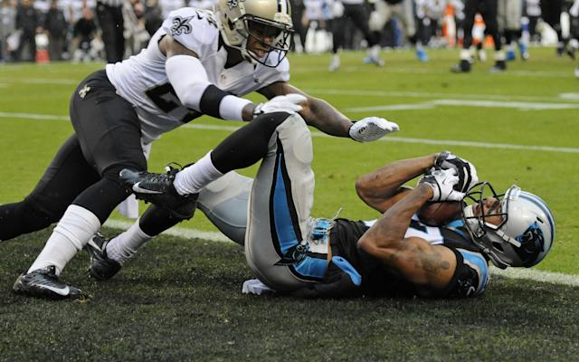 Carolina Panthers' Domenik Hixon, right, catches a touchdown pass as New Orleans Saints' Corey White defends in the second half of an NFL football game in Charlotte, N.C., Sunday, Dec. 22, 2013. (AP Photo/Mike McCarn)