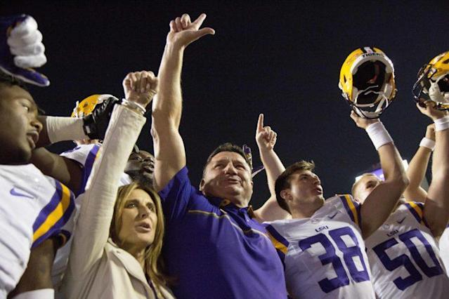 Head coach Ed Orgeron (middle) is serious about protecting his recruiting turf in Louisiana. (AP)