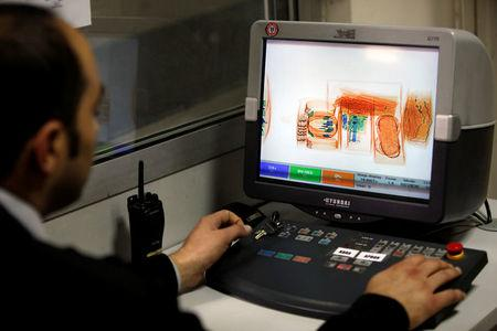 FILE PHOTO - A security official looks at a screen displaying X-ray screened parcels in Turkish Post's (PTT) postal logistic centre at the Ataturk International airport in Istanbul, Turkey on November 6, 2010. REUTERS/Murad Sezer/File Photo