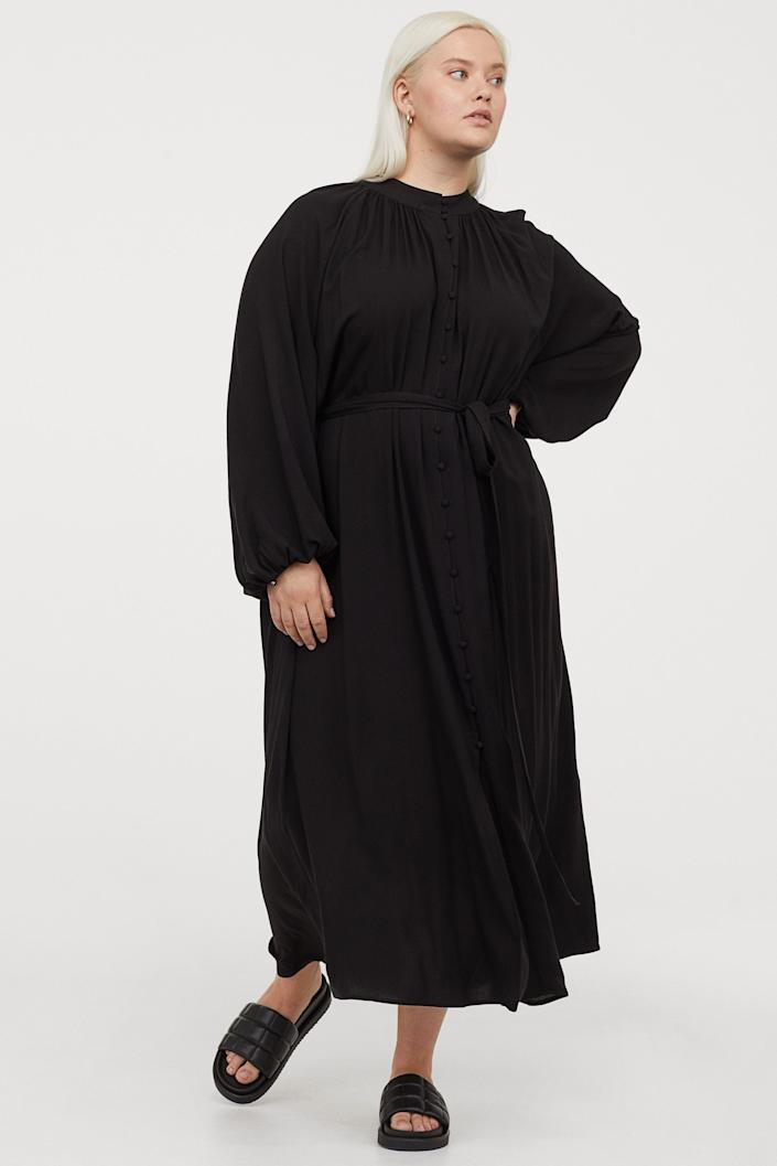 """No matter the season, a black puff-sleeved dress will always be in style. <br> <br> <strong>H&M Plus</strong> Plus-Size Tie-belt Dress, $, available at <a href=""""https://go.skimresources.com/?id=30283X879131&url=https%3A%2F%2Fwww2.hm.com%2Fen_us%2Fproductpage.0923070001.html"""" rel=""""nofollow noopener"""" target=""""_blank"""" data-ylk=""""slk:H&M"""" class=""""link rapid-noclick-resp"""">H&M</a>"""