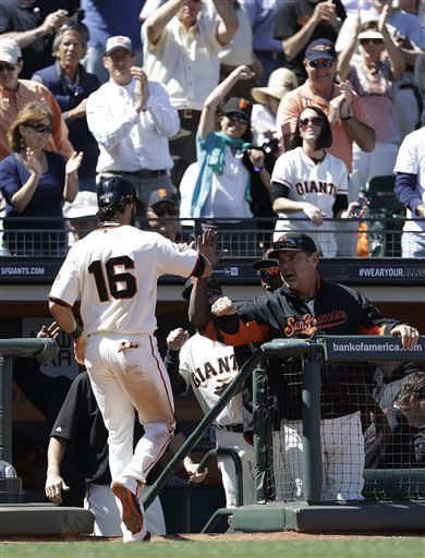 San Francisco Giants' Angel Pagan (16) is congratulated by manager Bruce Bochy after scoring against the Washington Nationals in the eighth inning of a baseball game on Wednesday, May 22, 2013, in San Francisco. (AP Photo/Ben Margot)