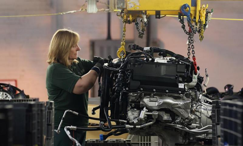 A worker at a Jaguar Land Rover factory