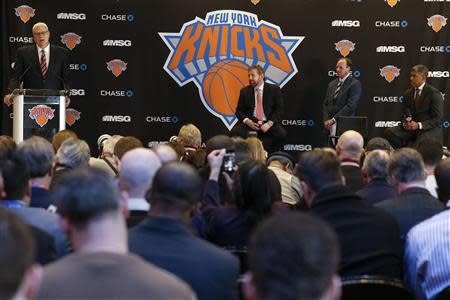 Phil Jackson (L) speaks during a news conference announcing him as the team president of the New York Knicks basketball team at Madison Square Garden in New York March 18, 2014.REUTERS/Shannon Stapleton