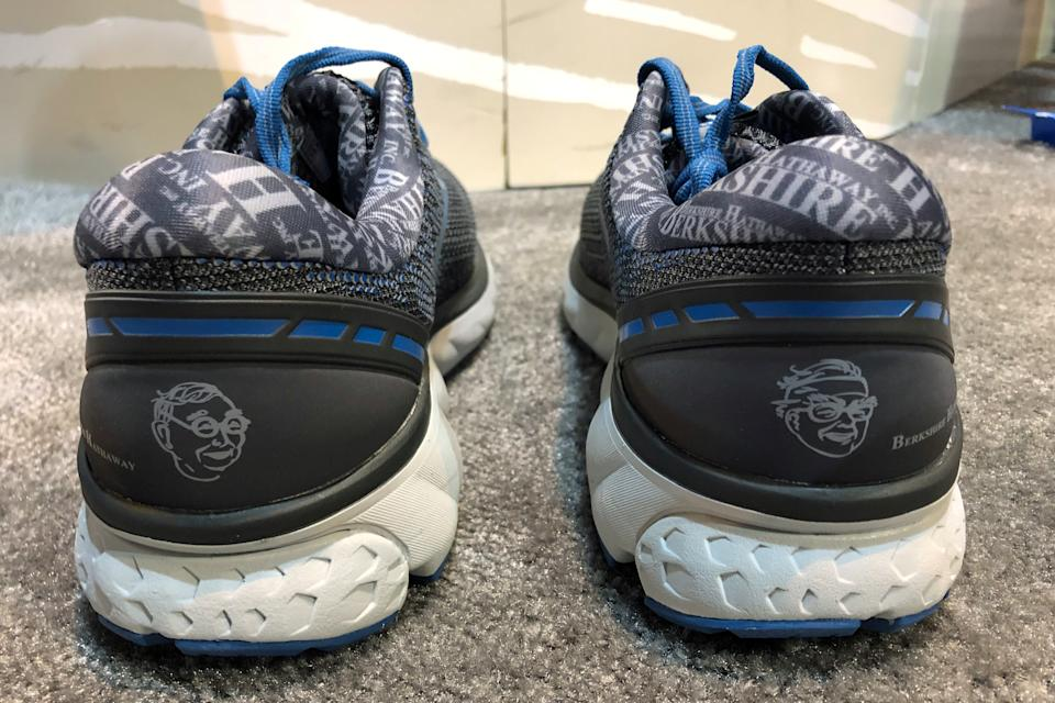 Special edition Brooks Ghost 11 running shoes featuring images of Berkshire Hathaway Chairman Warren Buffett and Vice Chairman Charlie Munger are seen at Berkshire's annual shareholder shopping day in Omaha, Nebraska, U.S., May 3, 2019.   REUTERS/Jonathan Stempel