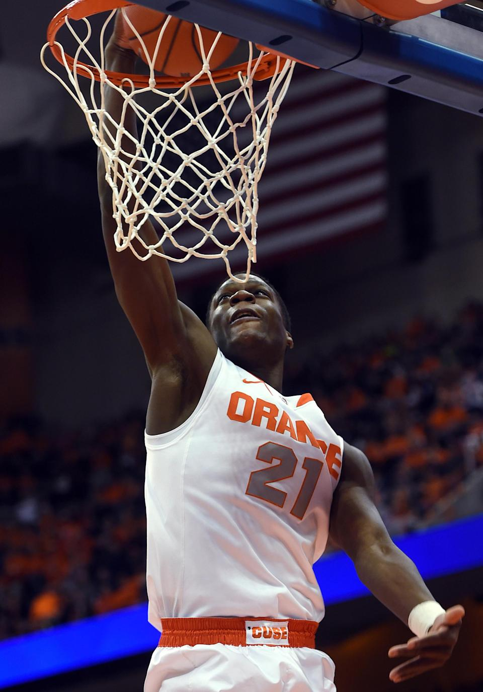 Syracuse's Tyler Roberson dunks against Colgate during the first half of an NCAA college basketball game in Syracuse, N.Y., Monday, Dec. 22, 2014. (AP Photo/Kevin Rivoli)