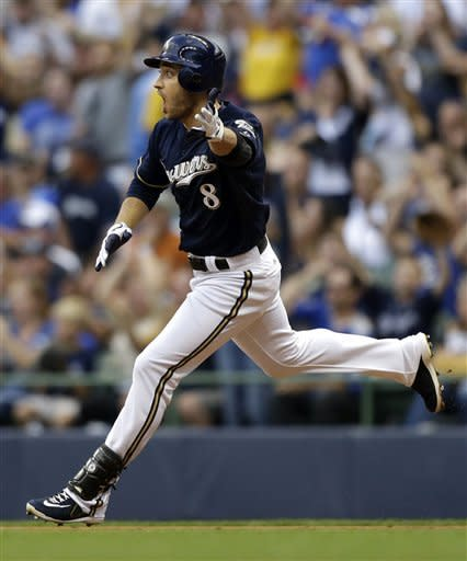 Milwaukee Brewers' Ryan Braun reacts to being caught in a rundown by the Philadelphia Phillies between first and second during the third inning of a baseball game on Saturday, Aug. 18, 2012, in Milwaukee. (AP Photo/Jeffrey Phelps)