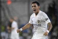 LA Galaxy forward Cristian Pavon celebrates after Los Angeles FC forward Latif Blessing scored an own goal during the first half of an MLS soccer match Saturday, July 18, 2020, in Kissimmee, Fla. (AP Photo/Phelan M. Ebenhack)