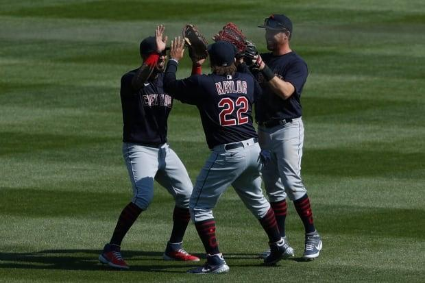 Naylor celebrates with teammates after a win over Detroit earlier this year.