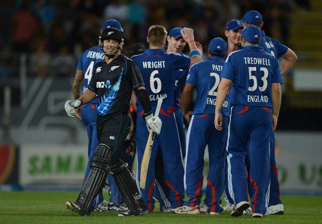 AUCKLAND, NEW ZEALAND - FEBRUARY 09:  Nathan McCullum of New Zealand leaves the field after being dismissed by Luke Wright of England during the 1st T20 International between New Zealand and England at Eden Park on February 9, 2013 in Auckland, New Zealand.  (Photo by Gareth Copley/Getty Images)