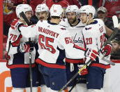 Washington Capitals right wing Brett Connolly (10) celebrates his goal against the Ottawa Senators with teammates during the first period of an NHL hockey game, Saturday, Dec. 22, 2018, in Ottawa, Ontario. (Justin Tang/The Canadian Press via AP)