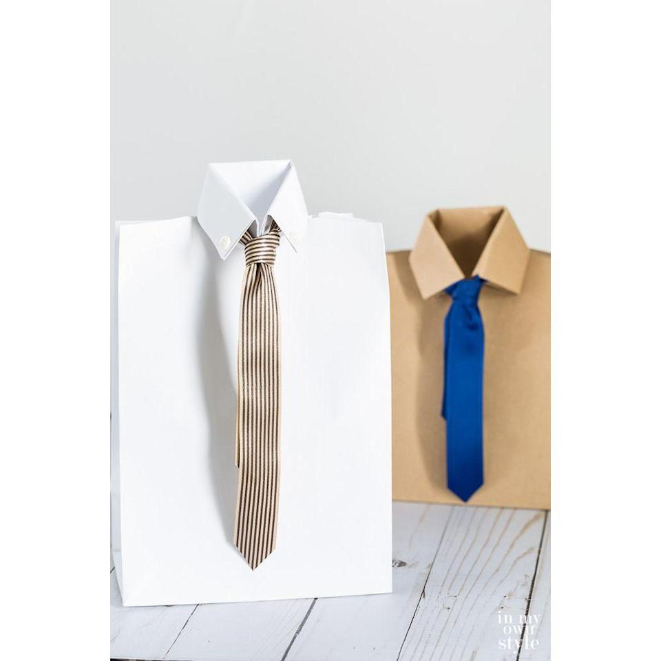 """<p>If you bought Dad a gift but still want to include something homemade, try customizing paper bags as the wrapping.</p><p><strong><em>Get the tutorial at <a href=""""https://inmyownstyle.com/the-cutest-fathers-day-gift-bag-ever.html"""" rel=""""nofollow noopener"""" target=""""_blank"""" data-ylk=""""slk:In My Own Style"""" class=""""link rapid-noclick-resp"""">In My Own Style</a>.</em></strong></p>"""
