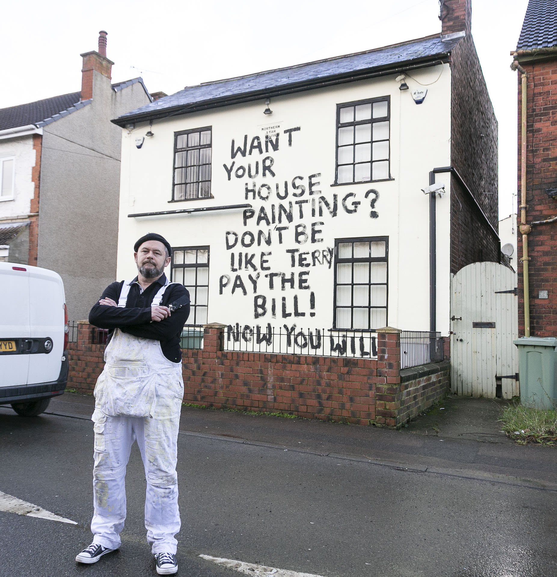 Painter and decorator, Dean Reeves 50, painted black graffiti on a house accusing the owner of not paying him, pictured in Bolsover in Derbyshire, January 17 2020. SWLEgraffiti