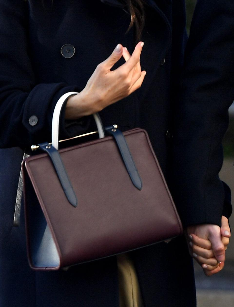 Meghan wore Strathberry's tri-colour tote bag in Nottingham in December 2018 [Photo: PA]