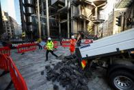Extinction Rebellion activists protest outside the Lloyd's building in London
