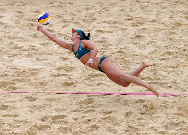 LONDON, ENGLAND - JULY 29: Becchara Palmer of Australia dives for the ball during Women's Beach Volleyball Preliminary match between Germany and Australia on Day 2 of the London 2012 Olympic Games at Horse Guards Parade on July 29, 2012 in London, England. (Photo by Ryan Pierse/Getty Images)